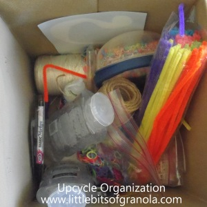 Upcycle Organization: How I used would-be trash items, like food cartons and cans, to take these storage cubes from this mess to organized and functional. -- by Little Bits of Granola
